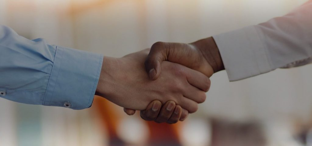 Two business person handshake